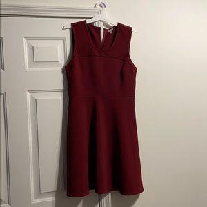A burgundy midi women's dress